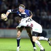 Leinster number 8 Jamie Heaslip offloads out of a tackle from Andrew Bishop