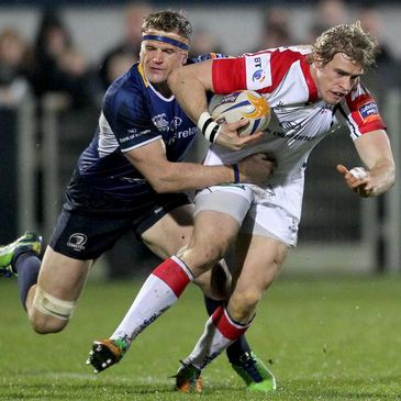 Jamie Heaslip tackles fellow Ireland international Andrew Trimble