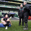 IRFU team services manager Ger Carmody and baggage master Paddy 'Rala' O'Reilly chat to Ireland captain Jamie Heaslip