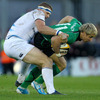 Leinster's stand-in captain Jamie Heaslip tackles Connacht speedster Fionn Carr, the 2010 IRUPA Young Player of the Year