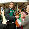 Number 8 Jamie Heaslip did some multi-tasking as he posed for photographs and signed autographs for the Ireland supporters
