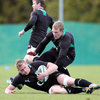 Keith Earls gets in over the top of the ball as Jamie Heaslip goes to ground at the Ireland squad's training base