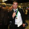 A clearly delighted Jamie Heaslip gestures for the cameras as the Leinster players make their way through the airport