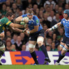 Leinster number 8 Jamie Heaslip gets past Northampton's Phil Dowson during the opening minutes of the Heineken Cup final