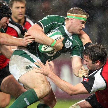 Jamie Heaslip is tackled by Canada's Sean-Michael Stephen