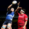 Jamie Heaslip stretches out to collect a lineout ball despite the best efforts of Edinburgh flanker Stuart McInally