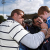 Number 8 Jamie Heaslip signs a young fan's jersey as the players and coaches mingle with the crowd