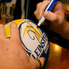 A close-up view of Jamie Heaslip signing a Leinster ball on the night
