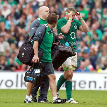 Jamie Heaslip leaves the pitch having taken a knock