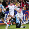 Ulster full-back Jared Payne, who set up the hosts' first try for Michael Allen, attempts to break away from Glasgow centre Alex Dunbar