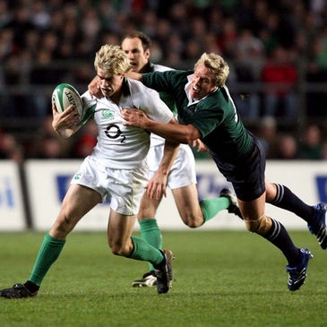 South Africa's Jean de Villiers tackles Irish winger Andrew Trimble