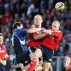 Leinster flanker Shane Jennings competes for a high ball with Munster's Paul O'Connell and Keith Earls
