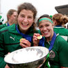Lynne Cantwell and centre partner Jenny Murphy, who was injured for the Italy game, display their Championship medals and the Six Nations trophy