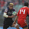 Ospreys flanker Jerry Collins races towards his former All Black colleague and Munster's first try scorer, Doug Howlett