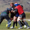 Jerry Flannery holds his ground during a training exercise for the players at Queenstown Events Centre
