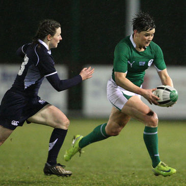 Ireland centre Joanne O'Sullivan gets past Scotland's Lucy Millard