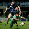 Benetton Treviso full-back Joe Maddock dives for the ball with Andrew Conway lurking behind him