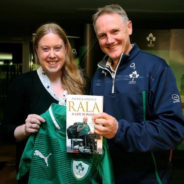 Joe Schmidt presents Emma Stewart with a signed Ireland jersey and a copy of Rala's book