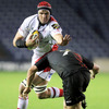 Ulster's Springbok lock Johann Muller looks to hand off Edinburgh's Ross Rennie during a competitive first half