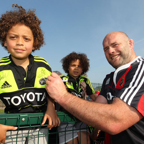John Hayes signs autographs for two young Munster fans