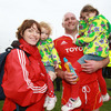 A thrilled John Hayes is pictured after the match with his wife Fiona and daughters Roisin and Sally