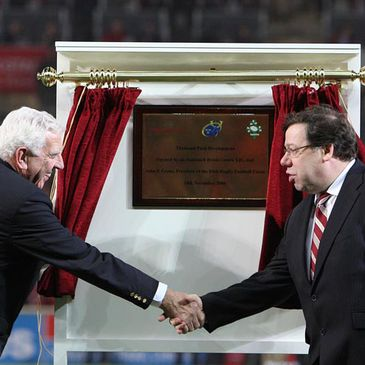 John Lyons and Taoiseach Brian Cowen shake hands after performing the official opening