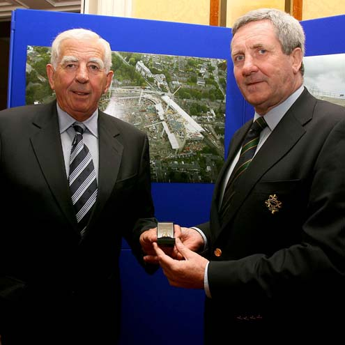 John Lyons is presented with his badge of office by Der Healy
