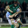Connacht captain John Muldoon keeps a tight hold of possession, under pressure from Bayonne's Remy Martin