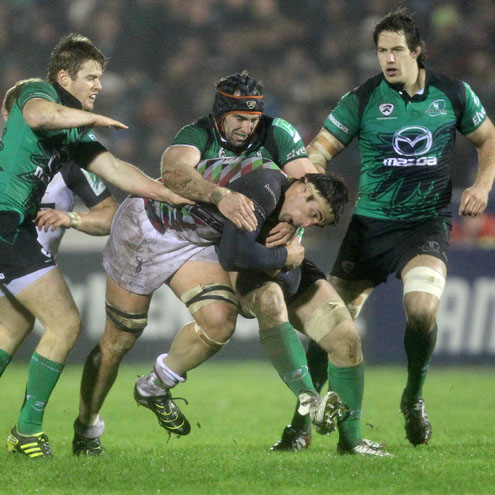 Connacht flanker John Muldoon tackles Harlequins' Tomas Vallejos