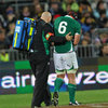 Connacht captain John Muldoon is helped off by Ireland team doctor Eanna Falvey, as he holds his broken right arm