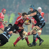 Munster full-back Johne Murphy is pictured trying to get past Cardiff's Sam Warburton and Michael Paterson in the early stages of the game