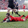 Winger Johne Murphy dives over to score his first Heineken Cup try for Munster, helping the province into a 22-13 lead