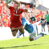 Munster centre Johne Murphy dives for the right corner, as Toulon's Felipe Contpomi tries to tackle him into touch