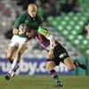 A bloodied Johnny O'Connor tries to brush off a tackle from Harlequins' busy scrum half Karl Dickson