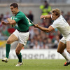 France centre Aurélien Rougerie reaches out to grab Jonathan Sexton's jersey as Ireland keep the pressure on