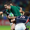 USA full-back Blaine Scully was equal to the challenge when he tried to halt the progress of Ireland's Jonathan Sexton