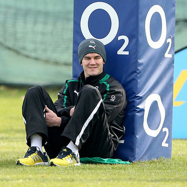 Jonathan Sexton watches his team-mates train today