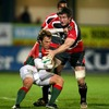 Portugal scrum half Jose Pinto is caught in possession by Ulster's Ed O'Donoghue