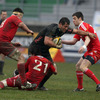 Aironi's Italy-capped flanker Josh Sole is challenged by Munster's replacement half-backs, Conor Murray and Declan Cusack