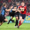 Munster's man-of-the-match Keith Earls gets away from a flailing Andrew Henderson