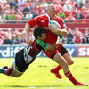 Munster's Keith Earls is caught in possession by Argentinian winger Gonzalo Camacho, who made some good runs for 'Quins