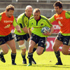 Keith Earls takes the ball on with forwards Stephen Archer, Paul O'Connell and Billy Holland in the background