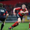Munster centre Keith Earls looks for space as he takes on his opposite number Rob Higgitt