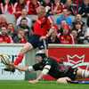 Ospreys captain Ryan Jones gets in to put off Munster's Keith Earls as he tries to race through for a try