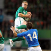 Italy winger Tommas Benvenuti can only look on as Keith Earls, on his 24th birthday, gets up well to gather a high ball
