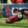 Ospreys scrum half Mike Phillips cannot prevent Keith Earls from scoring in the left corner