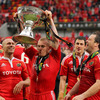 The scorer of Munster's second try, Keith Earls, gets soaked as he raises the Magners League trophy above his head