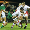 Ulster's Paddy Wallace is wrapped up in a tackle by Connacht centre Keith Matthews