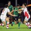 Connacht centre Keith Matthews takes the ball up, as Ulster's Paddy Wallace and Ian Whitten close him down