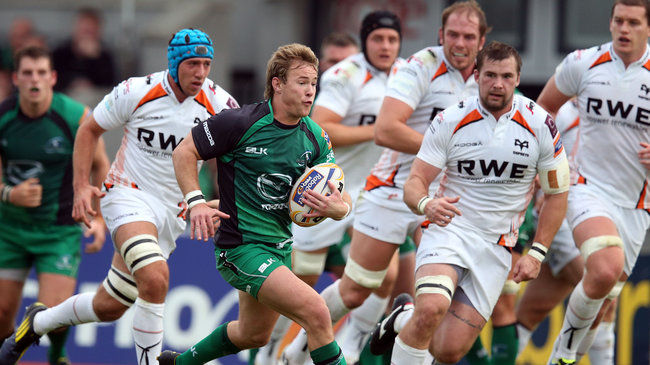 Kieran Marmion takes on the Ospreys defence